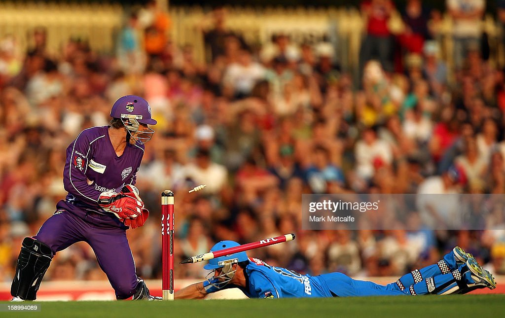 Callum Ferguson of the Strikers is run out by Owais Shah of the Hurricanes during the Big Bash League match between the Hobart Hurricanes and the Adelaide Strikers at Blundstone Arena on January 5, 2013 in Hobart, Australia.