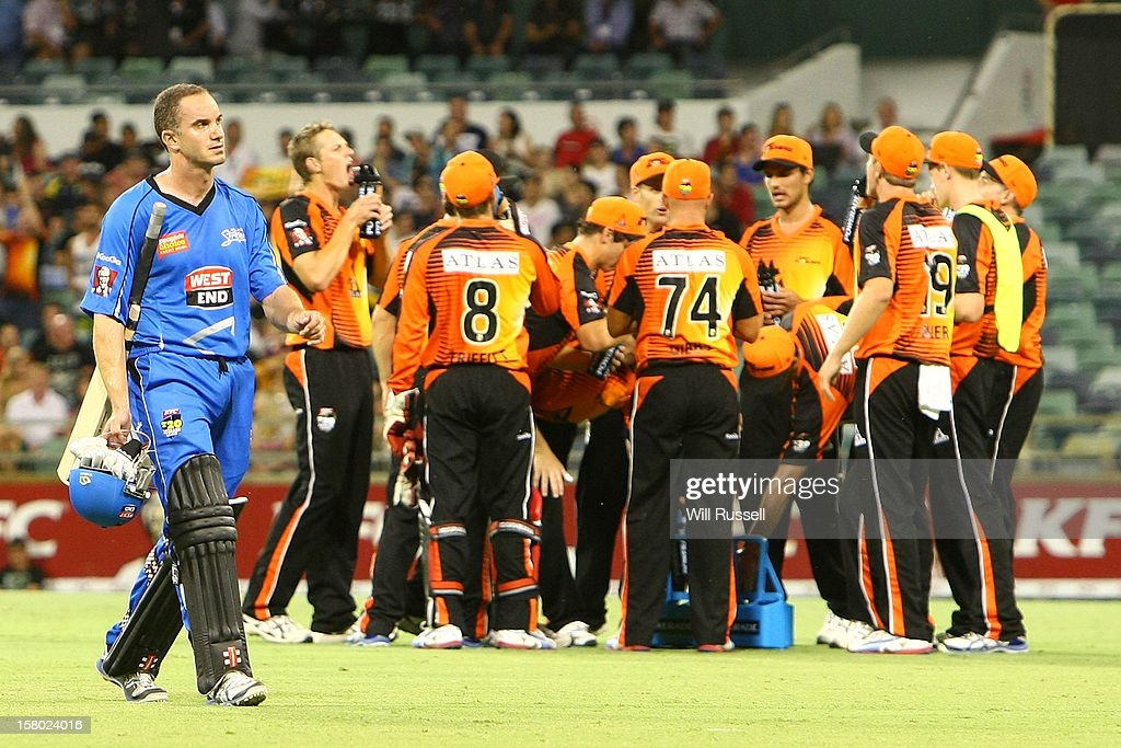 Callum Ferguson of the Strikers leaves the field after being caught by Adam Voges during the Big Bash League match between the Perth Scorchers and Adelaide Strikers at WACA on December 9, 2012 in Perth, Australia.