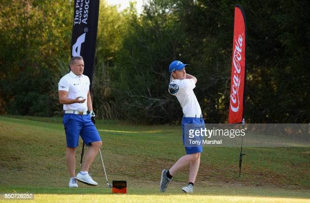 Callum Gaughan of Normanton Golf Club plays his first shot on the 1st tee as Scott McGovern of Normanton Golf Club watches his shot during The...