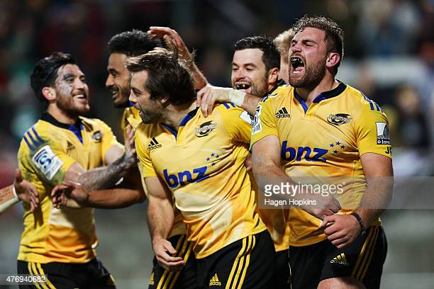 Callum Gibbins of the Hurricanes celebrates the try of Conrad Smith during the round 18 Super Rugby match between the Chiefs and the Hurricanes at...