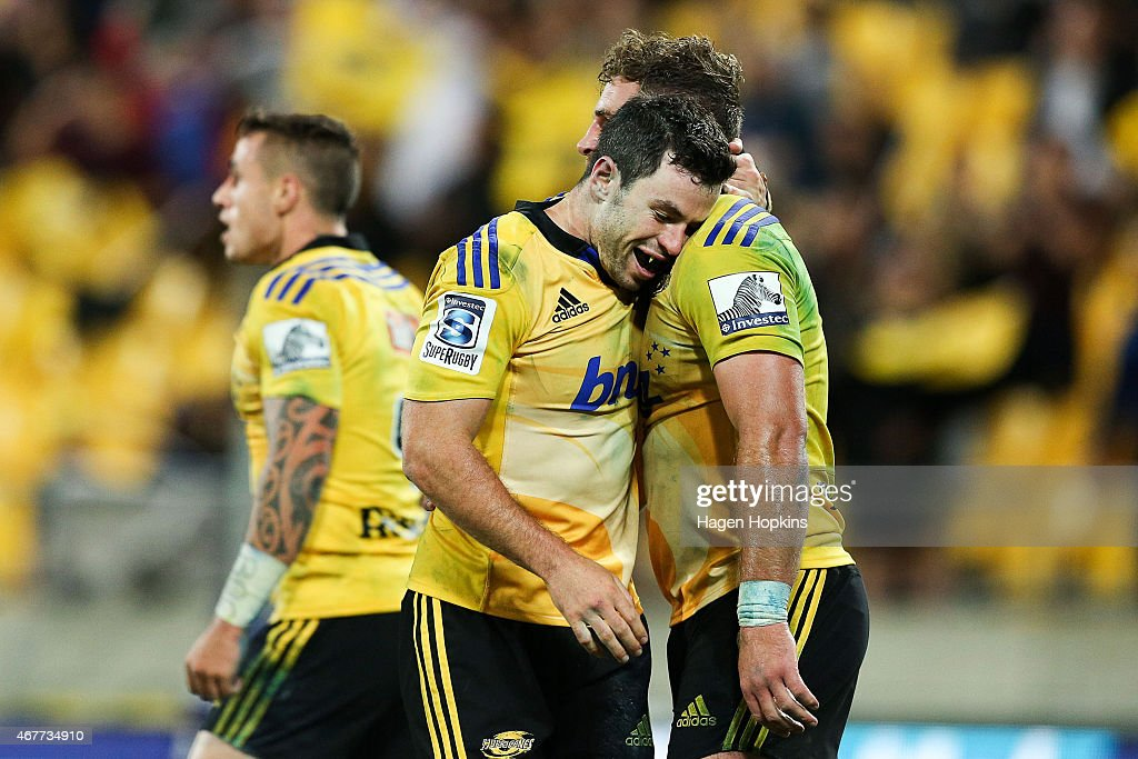 Callum Gibbins of the Hurricanes is congratulated on his try by teammate James Marshall during the round seven Super Rugby match between the...