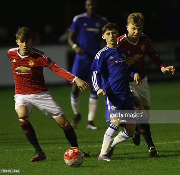 Callum Gribbin and Charlie Scott of Manchester United U18s in action with Kyle Scott of Chelsea U18s during the FA Youth Cup fourth round match...