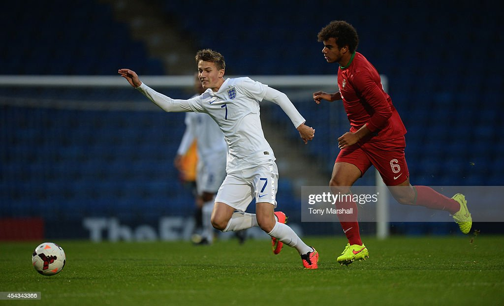 Callum Gribbin of England is tackled by Pedro Ferreira of Portugal during the Under 17 International match between England U17 and Portugal U17 at Proact Stadium on August 29, 2014 in Chesterfield, England.