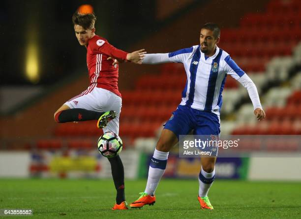 Callum Gribbin of Manchester United battles for the ball with Diogo Verdasca of Porto during the Premier League International Cup Quarter Final match...