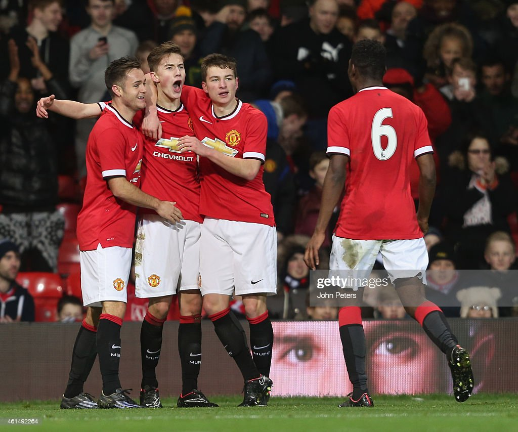 Callum Gribbin (2nd L) of Manchester United U18s celebrates scoring their third goal during the FA Youth Cup Fourth Round match between Manchester United U18s and Hull City U18s at Old Trafford on January 13, 2015 in Manchester, England.