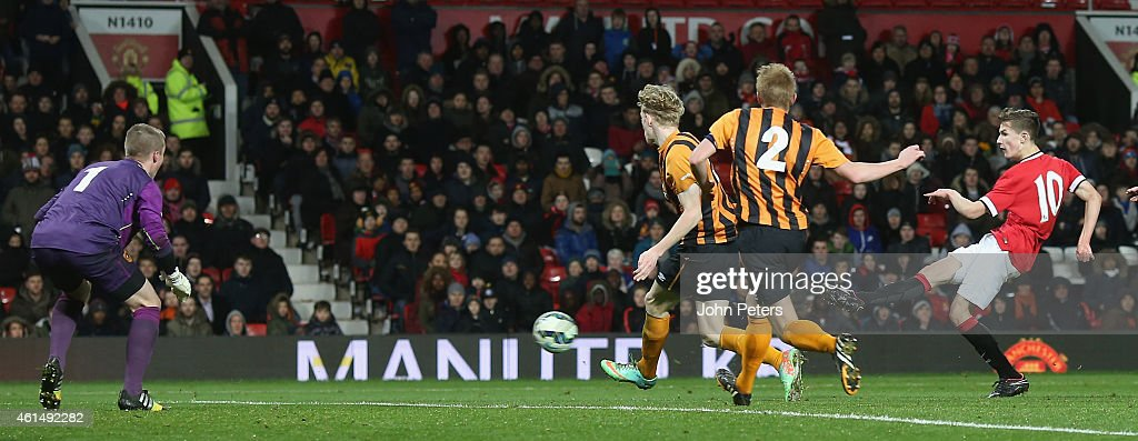 Callum Gribbin (C) of Manchester United U18s celebrates scoring their third goal during the FA Youth Cup Fourth Round match between Manchester United U18s and Hull City U18s at Old Trafford on January 13, 2015 in Manchester, England.