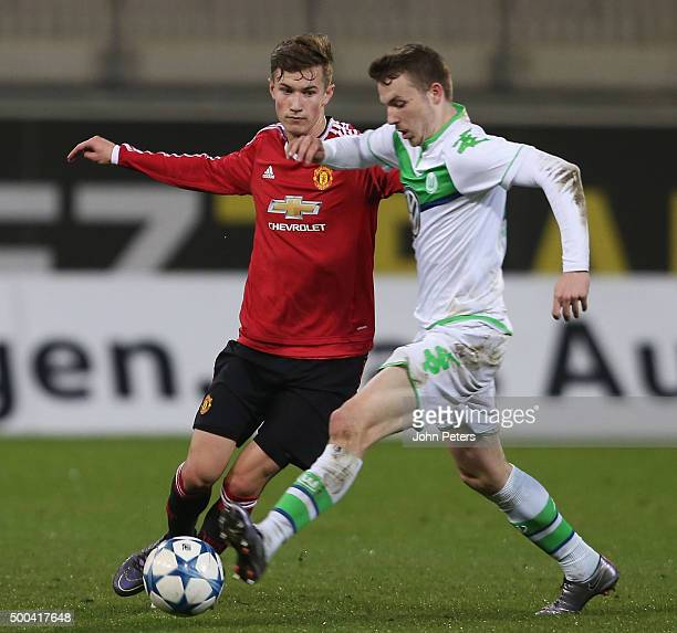 Callum Gribbin of Manchester United U19s in action with JannesKilian Horn of VfL Wolfsburg U19s during the UEFA Youth League match between VfL...