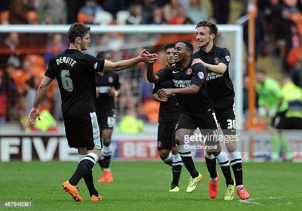 Callum Harriott of Charlton Athletic is congratulated by his teammates after scoring their third goal during the Sky Bet Championship match between...