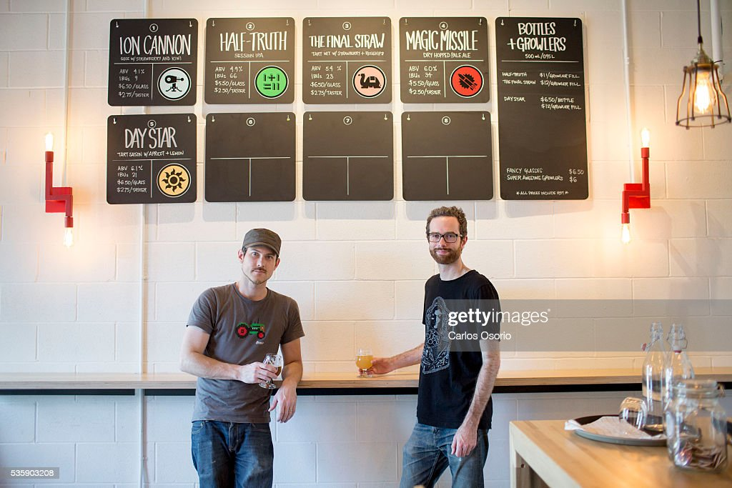 TORONTO, ON - MAY Callum Hay and Eric Portelance (glasses) are the co-founders of Halo Brewery in Toronto. May 30, 2016. For story on how craft breweries are banding together to survive, sharing ingredients and passing around knowledge