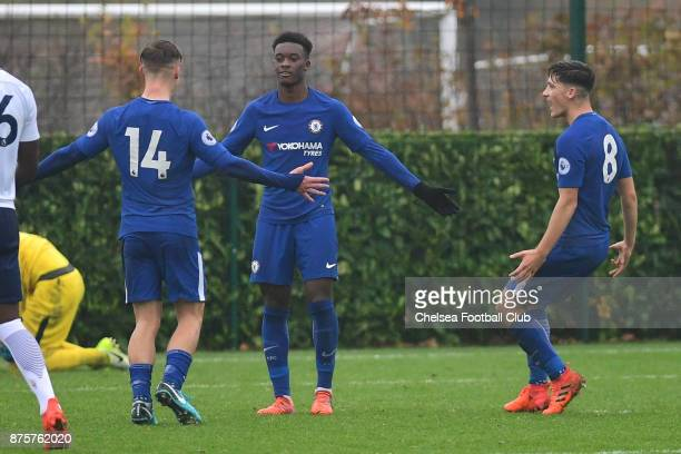 Callum HudsonOdoi of Chelsea celebrates his penalty goal with Luke McCormick and Ruben Sammut during the Premier league 2 match between Tottenham...