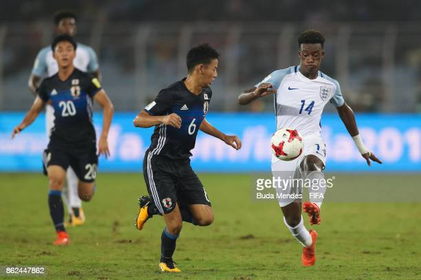 Callum HudsonOdoi of England battles for the ball with Hinata Kida of Japan during the FIFA U17 World Cup India 2017 Round of 16 match between...