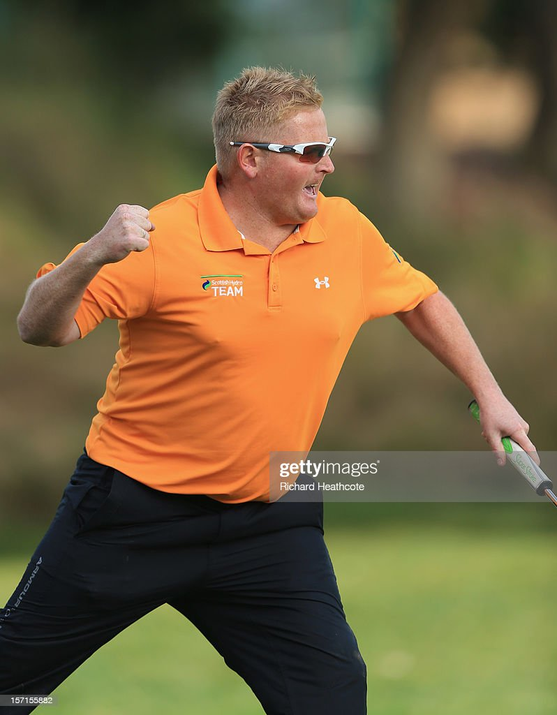 Callum Macaulay of Scotland celebrates a birdie putt from off the 18th green to secure his card for next season during the final round of the European Tour Qualifying School Finals at PGA Catalunya Resort on November 29, 2012 in Girona, Spain.