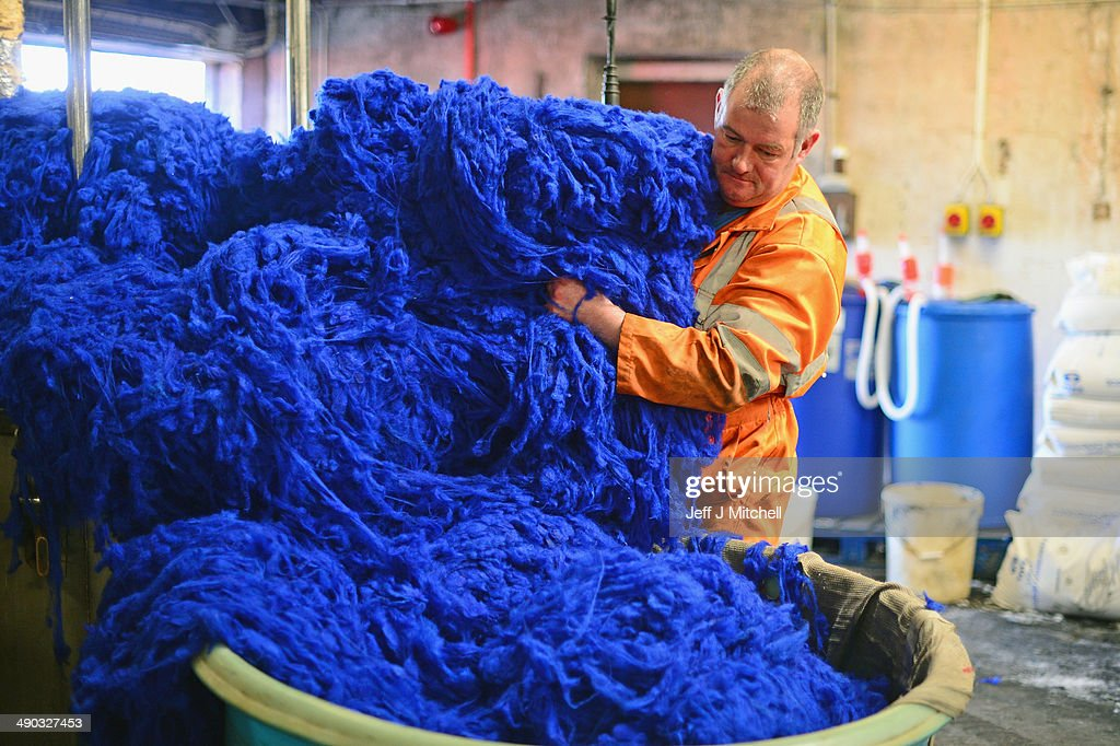Callum Macleod dying wool at the Harris Tweed Hebrides Company in Shawbost on May 13, 2014 in Stornoway, Scotland. Sales in one of Scotlands last cottage industries are soaring with Japan, Russia and Germany being some of the largest international importers of the cloth.