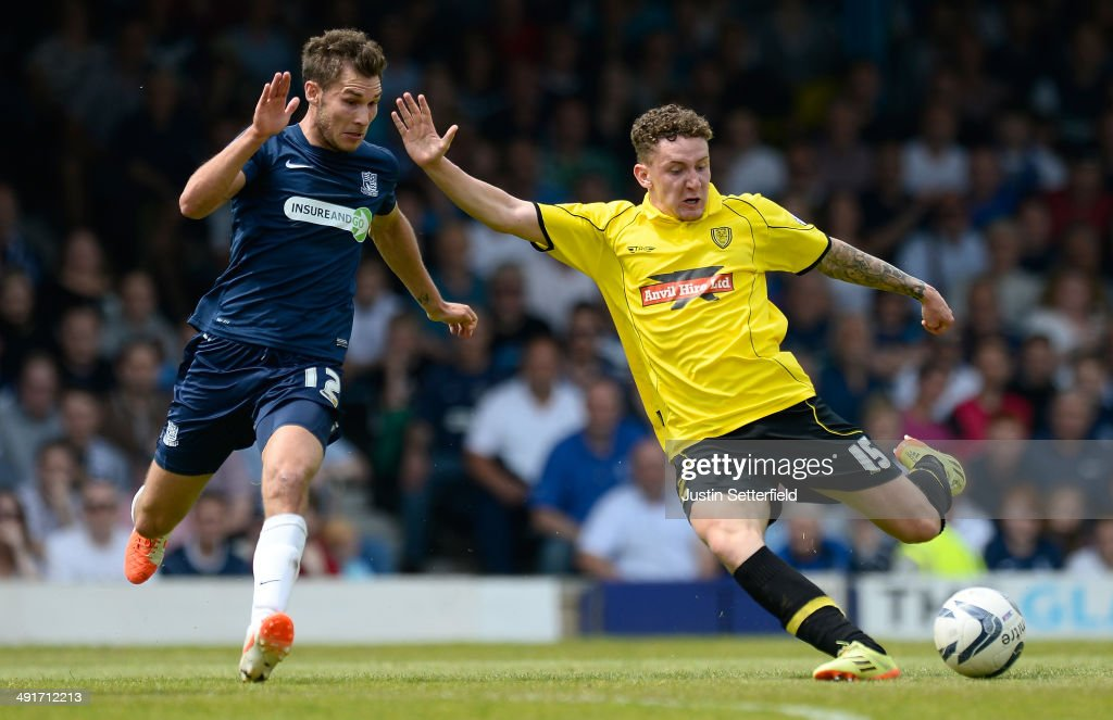 Callum McFadzean shoots during the Sky Bet League 2 Play Off Semi Final second leg match between Southend United and Burton Albion at Roots Hall on May 17, 2014 in Southend, England.