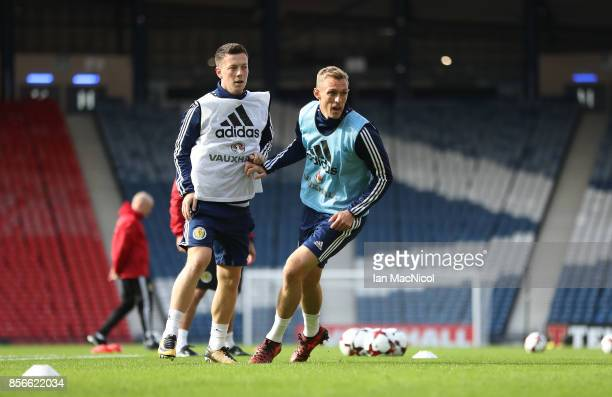 Callum McGregor and Darren Fletcher are seen during a training session ahead of the FIFA 2018 World Cup Qualifier against Slovakia at Hampden Park on...