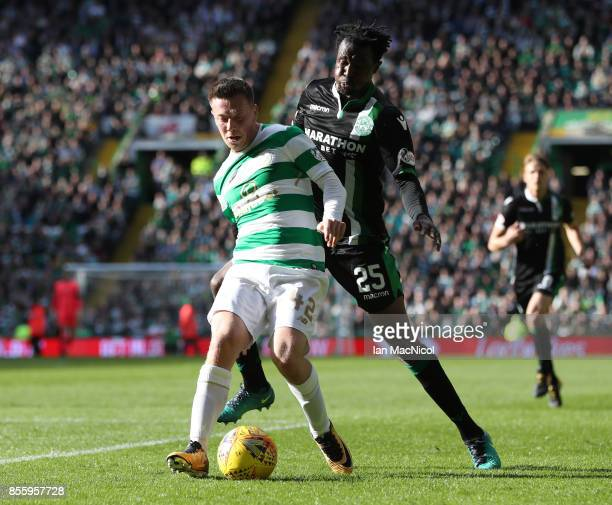 Callum McGregor of Celtic bids with Efe Ambrose of Hibernian during the Ladbrokes Scottish Premiership match between Celtic and Hibernian at Celtic...