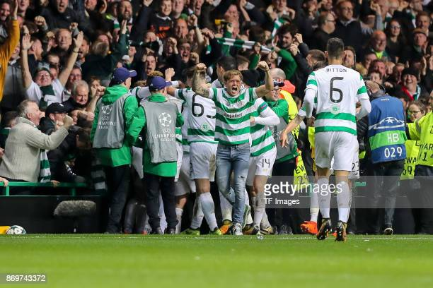 Callum McGregor of Celtic celebrates after scoring his team`s first goal with team mates during the UEFA Champions League group B match between...