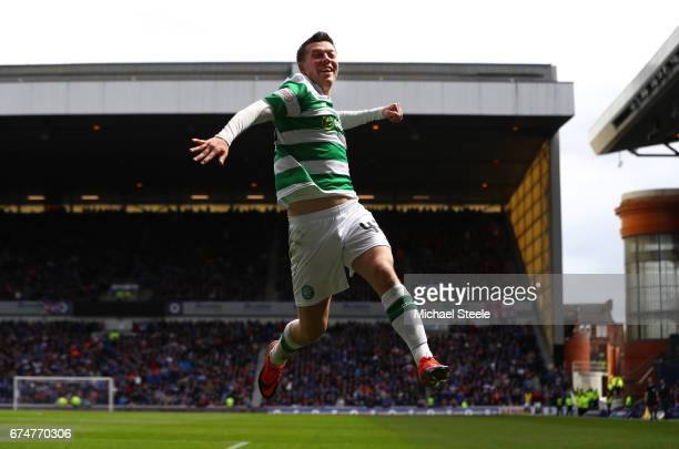 Callum McGregor of Celtic celebrates scoring his team's third goal during the Ladbrokes Scottish Premiership match between Rangers and Celtic at...