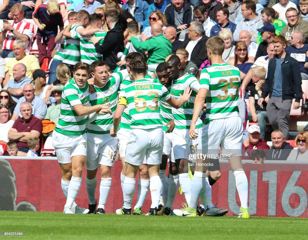 Callum McGregor of Celtic (R2) celebrates scoring the first goal during a pre-season friendly match between Sunderland AFC and Celtic at the Stadium of Light on July 29, 2017 in Sunderland, England.