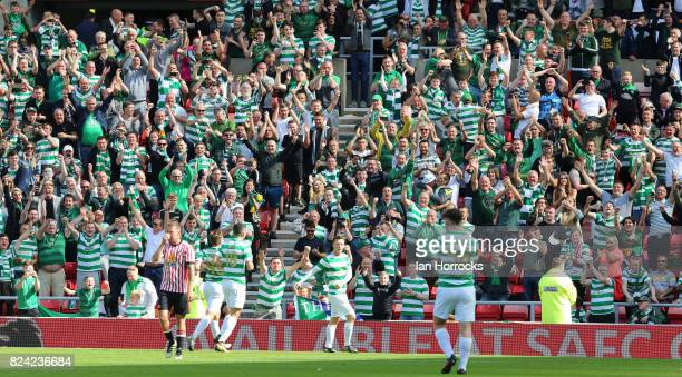 Callum McGregor of Celtic celebrates with his teammates after he scores his hattrick from the spot during a preseason friendly match between...
