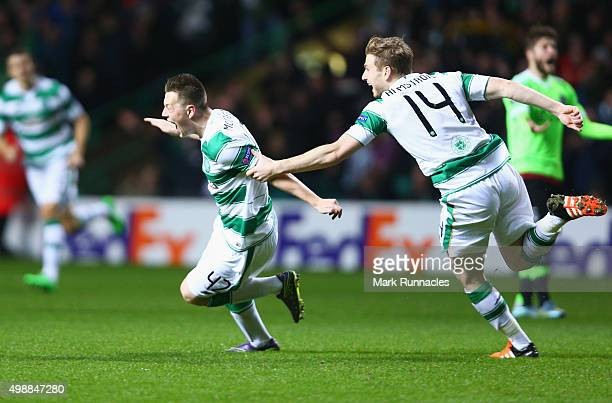 Callum McGregor of Celtic celebrates with Stuart Armstrong as he scores their first goal during the UEFA Europa League Group A match between Celtic...