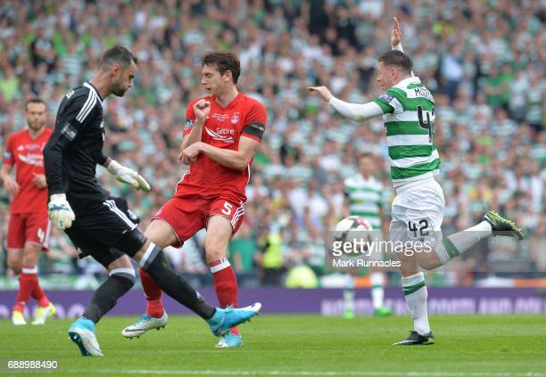 Callum McGregor of Celtic challenges Ash Taylor and Joe Lewis of Aberdeen for the ball during the William Hill Scottish Cup Final between Aberdeen...