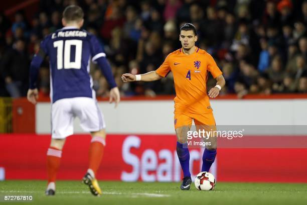 Callum McGregor of Scotland Karim Rekik of Holland during the friendly match between Scotland and The Netherlands on November 09 2017 at Pittodrie...