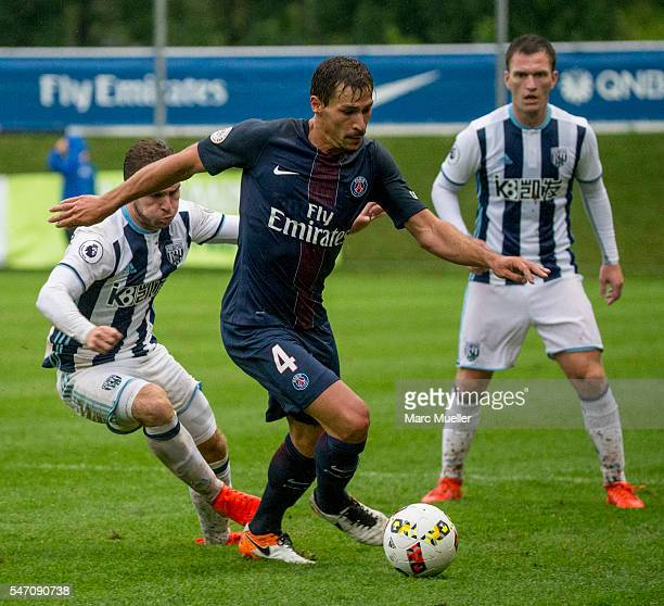 Callum McManaman of West Bromwich Albion is challenged by JBenjamin Stambouli of Paris St Germain during a friendly match on July 13 2016 in...