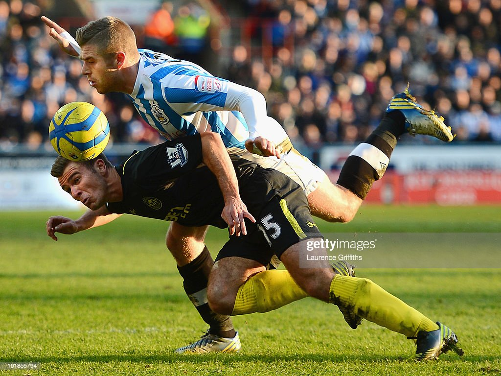 <a gi-track='captionPersonalityLinkClicked' href=/galleries/search?phrase=Callum+McManaman&family=editorial&specificpeople=5872412 ng-click='$event.stopPropagation()'>Callum McManaman</a> of Wigan Athletic tangles with Adam Clayton of Huddersfield Town during the FA Cup with Budweiser Fifth Round match between Huddersfield Town and Wigan Athletic at John Smith's Stadium on February 17, 2013 in Huddersfield, England.