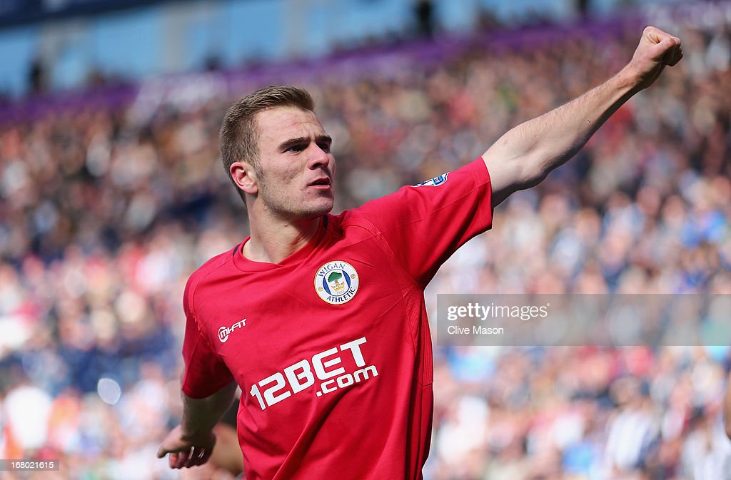 <a gi-track='captionPersonalityLinkClicked' href=/galleries/search?phrase=Callum+McManaman&family=editorial&specificpeople=5872412 ng-click='$event.stopPropagation()'>Callum McManaman</a> of Wigan celebrates his team's third goal during the Barclays Premier League match between West Bromwich Albion and Wigan Athletic at The Hawthorns on May 4, 2013 in West Bromwich, England.