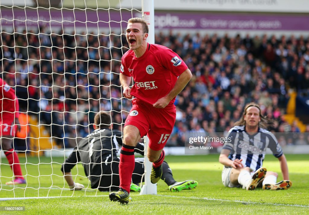 <a gi-track='captionPersonalityLinkClicked' href=/galleries/search?phrase=Callum+McManaman&family=editorial&specificpeople=5872412 ng-click='$event.stopPropagation()'>Callum McManaman</a> of Wigan celebrates his third goal during the Barclays Premier League match between West Bromwich Albion and Wigan Athletic at The Hawthorns on May 4, 2013 in West Bromwich, England.