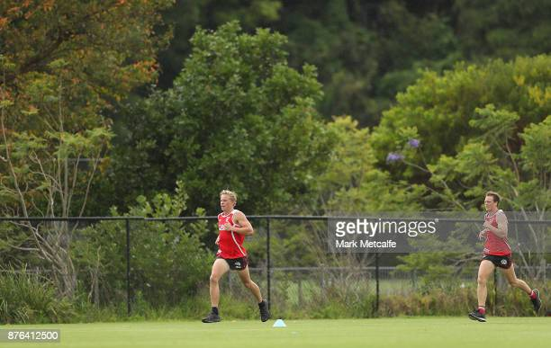 Callum Mills and Isaac Heeney run during a Sydney Swans AFL preseason training session at Sydney Grammar on November 20 2017 in Sydney Australia