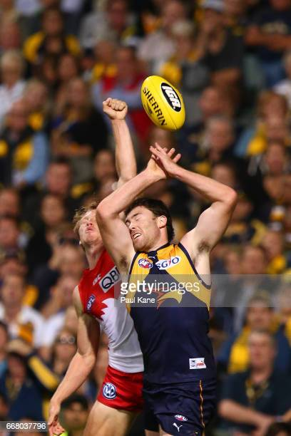 Callum Mills of the Swans and Jeremy McGovern of the Eagles contest a mark during the round four AFL match between the West Coast Eagles and the...