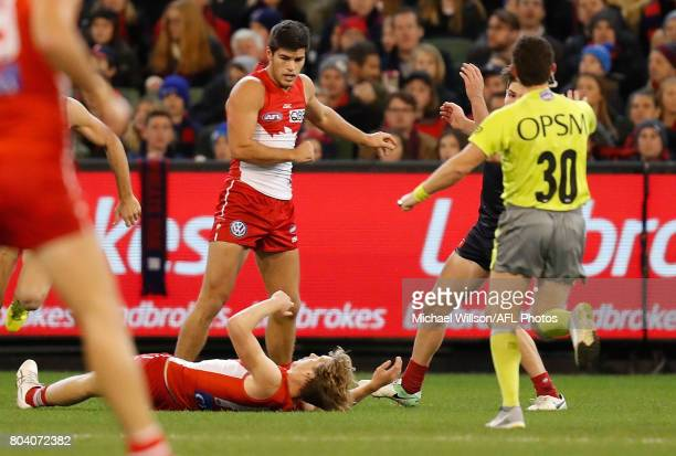 Callum Mills of the Swans and Tomas Bugg of the Demons clash during the 2017 AFL round 15 match between the Melbourne Demons and the Sydney Swans at...