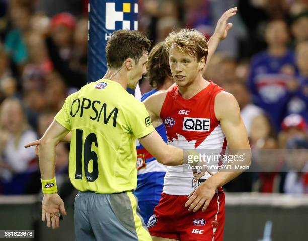 Callum Mills of the Swans argues with the umpire after a free kick was paid against him during the 2017 AFL round 02 match between the Western...