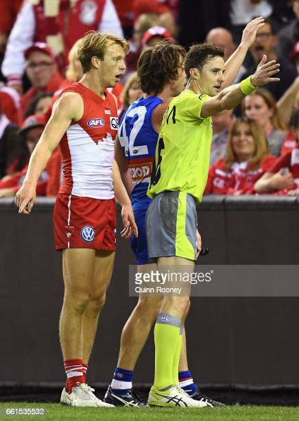 Callum Mills of the Swans argues with the umpire after he payed a deliberate rushed behind against him during the round two AFL match between the...