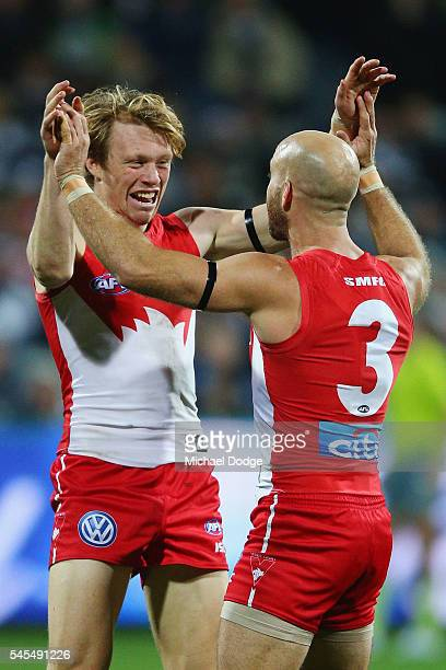 Callum Mills of the Swans celebrates a goal with Jarrad McVeigh during the round 16 AFL match between the Geelong Cats and the Sydney Swans at...