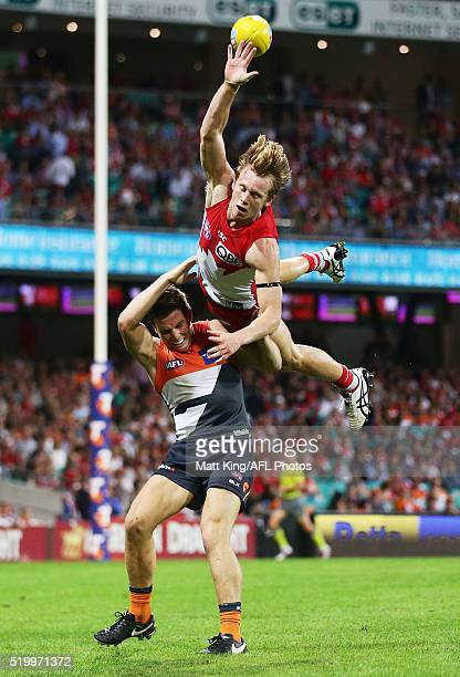 Callum Mills of the Swans flies over the top of Toby Greene of the Giants during the round three AFL match between the Sydney Swans and the Greater...