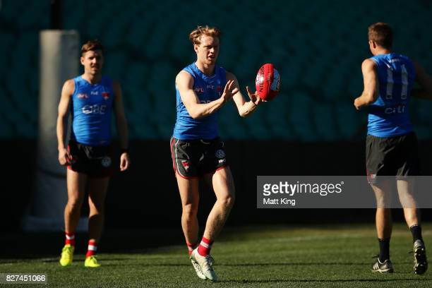 Callum Mills of the Swans handles the ball during a Sydney Swans AFL training session at Sydney Cricket Ground on August 8 2017 in Sydney Australia