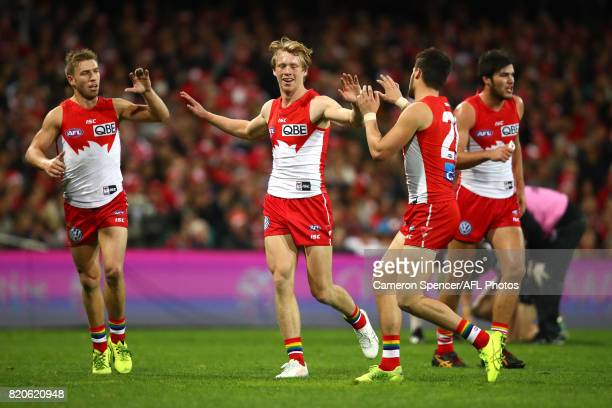 Callum Mills of the Swans is congratulated by team mates after tackling Blake Acres of the Saints during the round 18 AFL match between the Sydney...