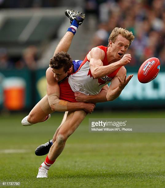 Callum Mills of the Swans is tackled by Zaine Cordy of the Bulldogs during the 2016 Toyota AFL Grand Final match between the Sydney Swans and the...