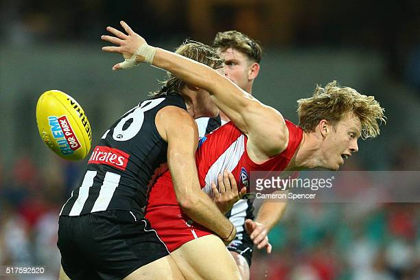 Callum Mills of the Swans is tackled during the round one AFL match between the Sydney Swans and the Collingwood Magpies at Sydney Cricket Ground on...