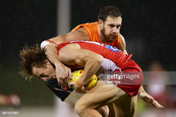 Callum Mills of the Swans is tackled high by Shane Mumford of the Giants during the 2017 JLT Community Series AFL match between the Greater Western...