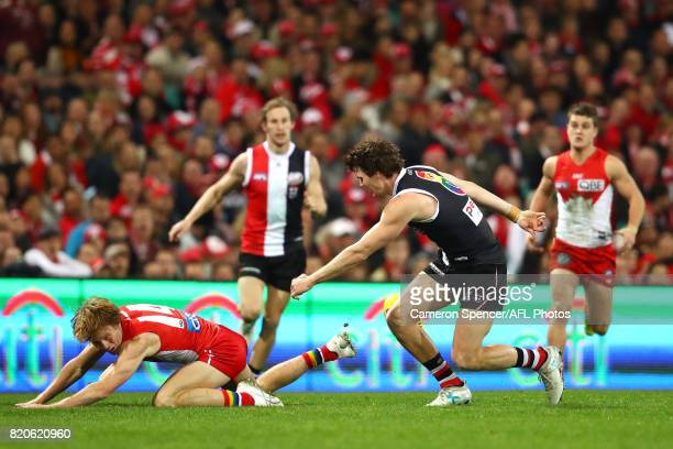Callum Mills of the Swans tackles Blake Acres of the Saints during the round 18 AFL match between the Sydney Swans and the St Kilda Saints at Sydney...