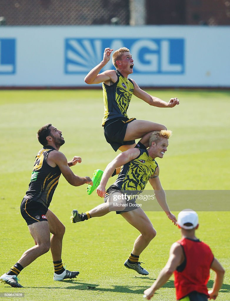 Callum Moore of the Tigers jumps for an attempted mark early over Steven Morris of the Tigers during the Richmond Tigers AFL intra-club match at Punt Road Oval on February 12, 2016 in Melbourne, Australia.