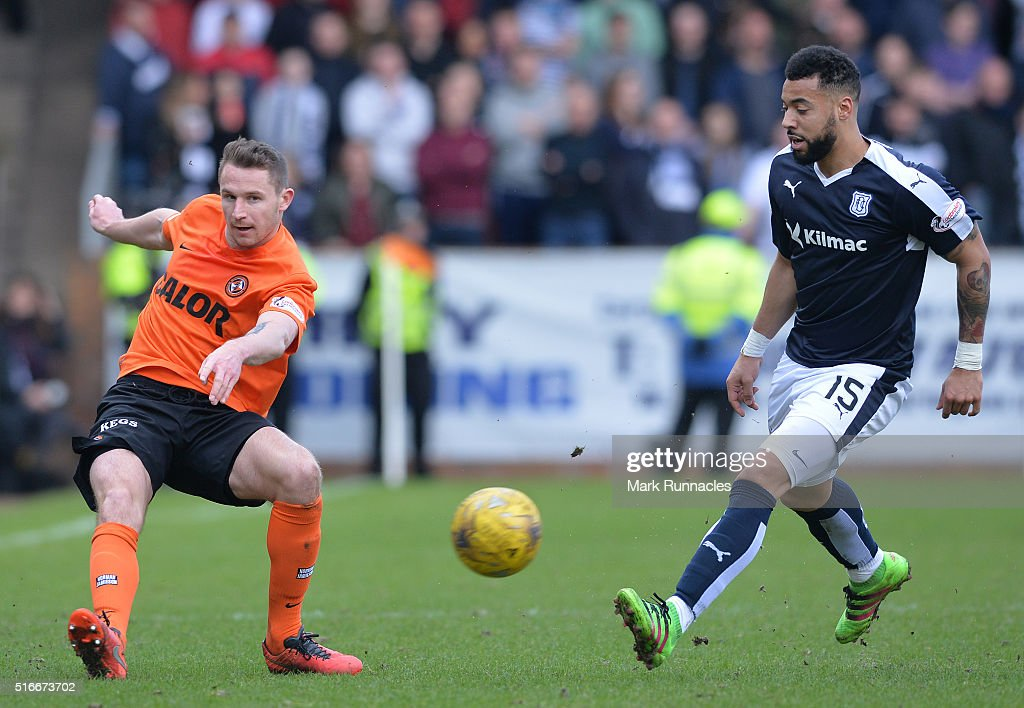 Callum Morris of Dundee United clears from Kane Hemmings of Dundee during the Ladbrokes Scottish Premiership match between Dundee United FC and...