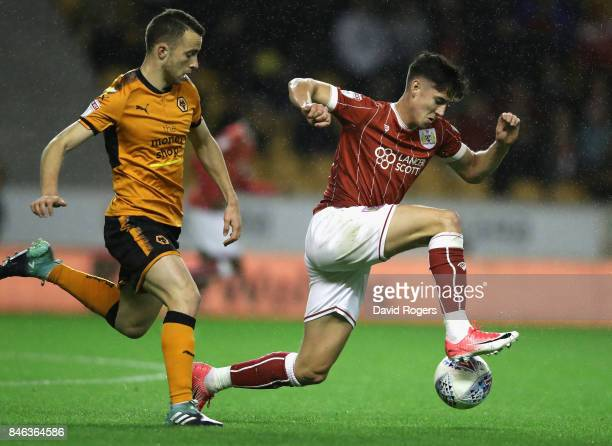 Callum O'Dowda of Bristol City moves away from Diogo Jota during the Sky Bet Championship match between Wolverhampton Wanderers and Bristol City at...