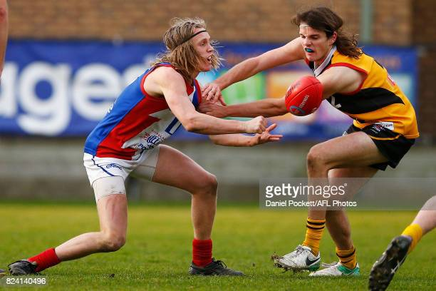 Callum Porter of the Power handpasses the ball under pressure during the round 14 TAC Cup match between Dandenong and Gippsland at Frankston Oval on...