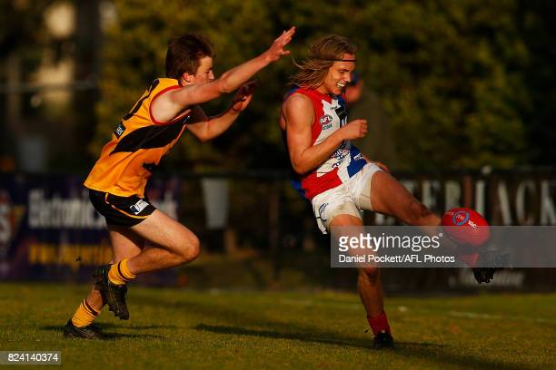 Callum Porter of the Power kicks the ball under pressure during the round 14 TAC Cup match between Dandenong and Gippsland at Frankston Oval on July...
