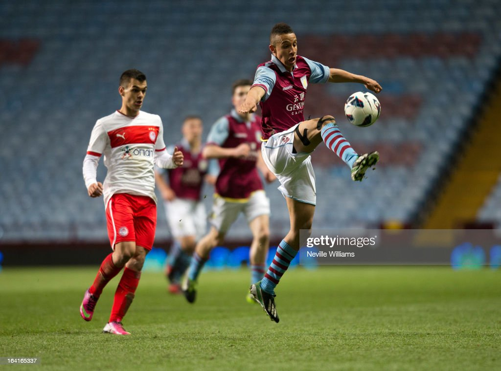 Callum Robinson of Aston Villa U19 is challenged by Charalampos Lykogiannis of Olympiacos U19 during the NextGenSeries Quarter Final match at Villa Park on March 20, 2013 in Birmingham, England.